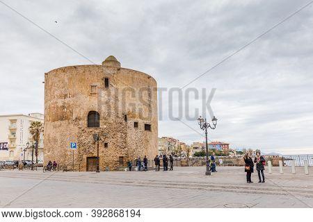 Alghero, Sardinia Island, Italy - December 28, 2019: Torre Di Sulis Standing On The Boulevard Of Alg