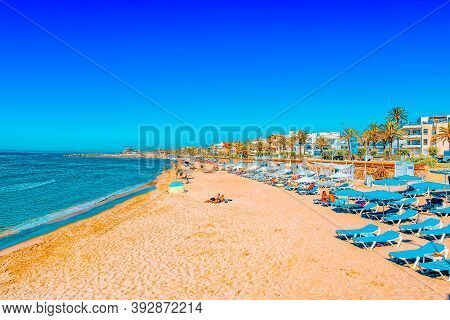 View Of The Beach And The Sea Shore Of A Small Resort Town Sitge