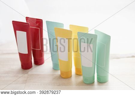 Collection Of Various Beauty Hygiene Tubes On White Background, Natural Light. Hygienic Concept