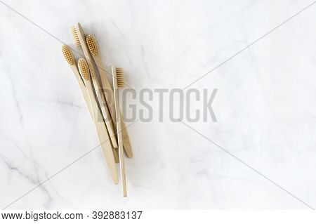 Composition With Biodegradable Bamboo Toothbrushes On Marble Background. Sustainable, Zero Waste, Pl
