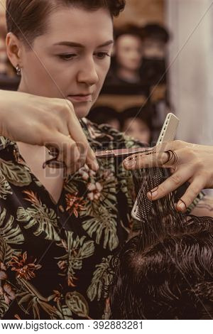 The Process Of Working With The Hair Of Professional Barbers Clients