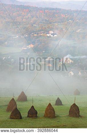 breb maramures in autumn fog traditional Romanian village