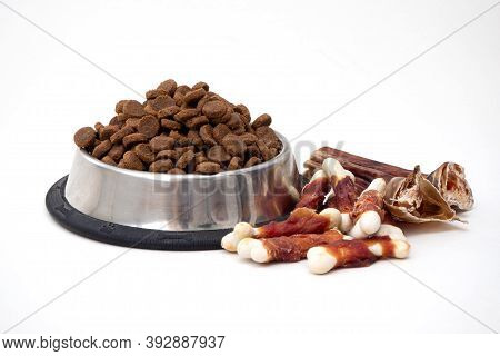Dog Treats And Dry Feed In Bowl On White Background With Copy Space. Variety Of Dog Treats. Flat Lay