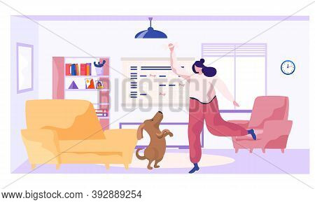 The Girl Is Training The Animal At Home. The Dog Is Standing On Its Hind Legs. Woman Holding Bone In
