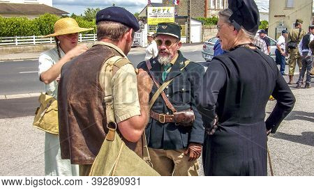 Sainte Mere L'eglise, France - June 6, 2019. Parade Of People Dressed Up In 1940's Clothing Posing I