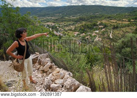A Woman Looking The Valley In The French Countryside
