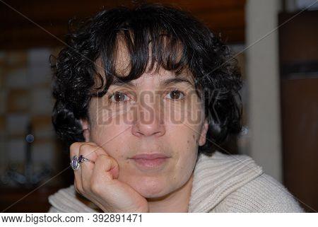 Portrait Of A Smiling Mature Brunette Woman