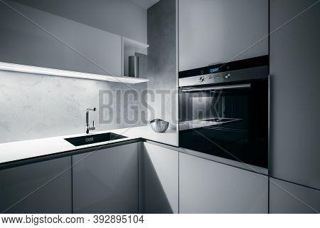 Modern White Kitchen Corner In Minimalist Design, During Night, With Light Strip Turned On, Modern O