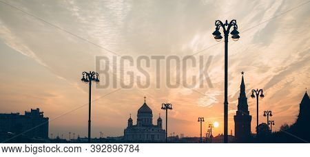 Sunset Over Historic Center Of City With Soaring Street Lights Towards The Sky. Sky Is Clear With Sm