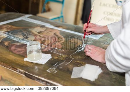 Parma, Italy - September 2020: Hands Of A Restorer With A Brush: Working On The Restoration Of A Pai