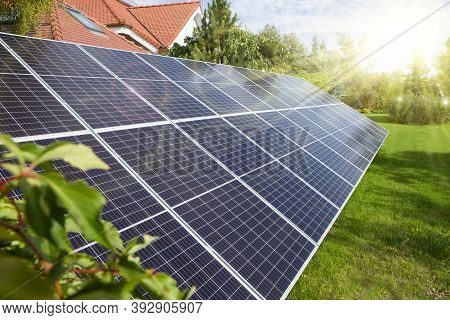 Solar Panel, Photovoltaics, Alternative Source Of Electricity - Set In The Garden By The House.solar