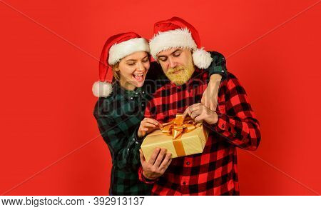 Couple In Love With Gift. Christmas Time. Man And Woman Christmas Holiday Celebration. Giving Presen