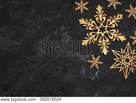 Christmas or New Year dark wooden background, Xmas black board framed with season decorations, space