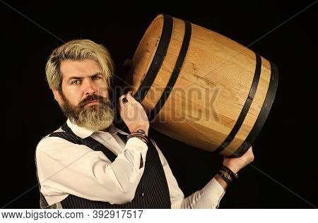 Male Winemaker. Bearded Man Explore Taste Of Wine In Restaurant. Checking Color And Sediments Of Win