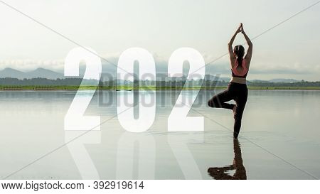 Happy New Year Start Up 2021.  Yoga Women Lifestyle Exercise And Pose For Healthy Life. People Balan