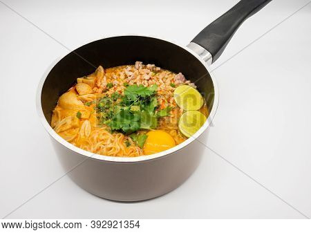 Pork Spicy 'tom Yum' With Instant Noodle Soup In Hot Pot Isolated On White