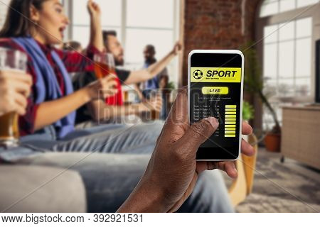 Device Screen With Mobile App For Betting And Score. Device With Match Results On Screen, Excited Fa