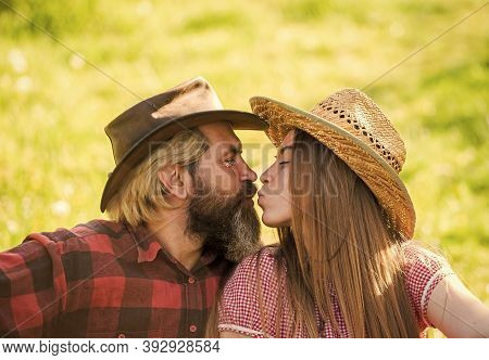 Love And Harmony. Bearded Cowboy In Hat Kissing Adorable Girlfriend. Couple In Love. Romantic Kiss.