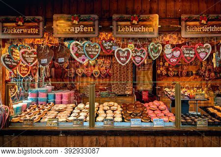 VIENNA, AUSTRIA - DECEMBER 03, 2019: Wooden kiosk with traditional homemade sweets and cookies on annual Christmas market held in different parts of the Vienna, Austria.