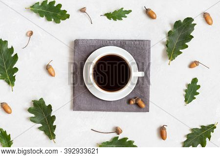 Black Coffee With Acorns And Oak Leaves On A White Background. Homemade Acorn Coffee. Caffeine Subst