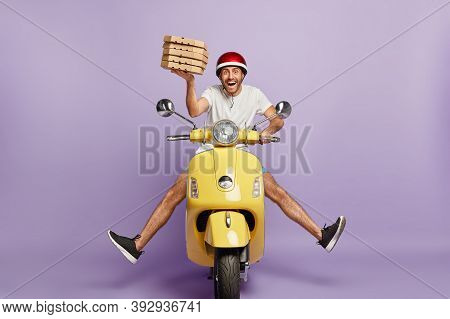 Busy Deliveryman Being In Hurry, Carries Cardboard Boxes With Pizza, Delivers To Customers, Poses On