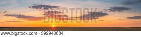 Landscape Of Wheat Field Under Scenic Summer Dramatic Sky In Sunset Dawn Sunrise. Skyline. Panorama,
