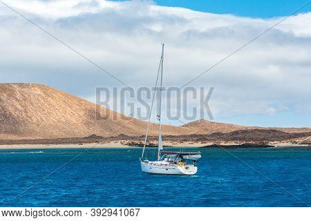 Corralejo, Fuerteventura, Spain: 2020 September 30: Boat In The Sea Near Corralejo In Fuerteventura