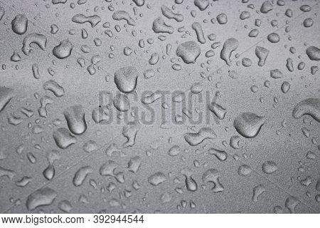 Raindrops On The Silvery Surface Of The Car. Selective Focus.