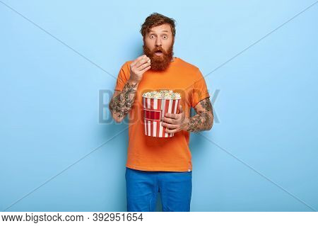 Ginger Shocked Man Eats Popcorn, Watches Horror Film Alone At Night, Has Impressive Look, Wears Oran
