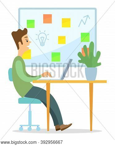 Office Worker, Ceo Or Businessman Sitting At Desk And Working On Laptop. Big Board With Colorful Squ