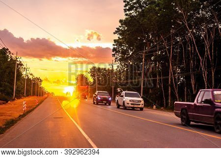 Pattalung, Thailand - August 29, 2020 : Car On Road With Colorful Of Sunset Or Sunrise In Twilight