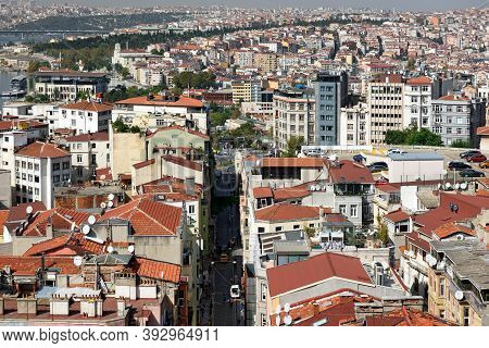 ISTANBUL, TURKEY - OCTOBER 07, 2020. Skyline of Istanbul, as seen from Galata Tower. View of the Buyuk Hendek street in the Beyoglu District. City of Istanbul, Turkey.
