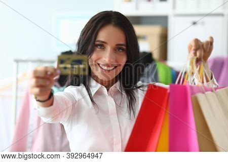 Happy Girl At Home Shows Credit Card And Packages. Make Purchases With Credit Card During Self-isola