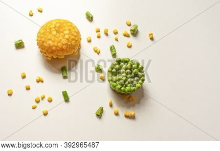 Frozen Vegetables Close-up On A White Background. Frozen Corn, Green Peas, Chopped Green Beans. Heal