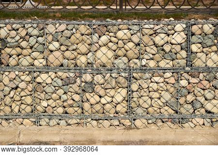 Wall Of River Bed Of Gabions Filled With Boulders
