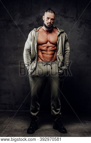 Handsome And Powerful Athlete With Naked Torso And Perfect Abs And With Beard And Moustache Poses In
