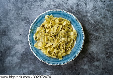 Pappardelle Pasta In Plate Ready To Serve And Eat. Traditional Dish.