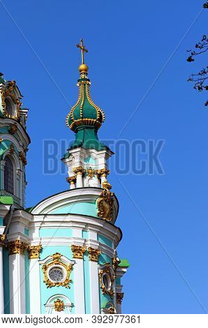 Close-up View The Top Of Charming Saint Andrew Church Against Blue Sky. It Is A Major Baroque Church