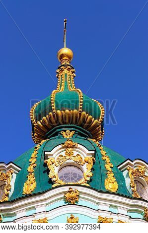 Detailed View The Top Of Ancient Saint Andrew Church Against Blue Sky. It Is A Major Baroque Church.