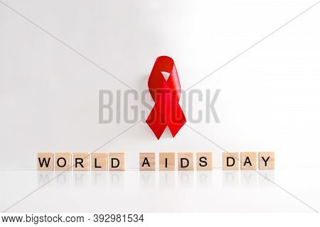 1 December World Aids Day Made Of Wooden Letters And Ribbon Bymbol Side View. Aids And Hiv Awareness