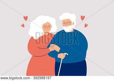 Elderly Couple Hold With Hands. Senior Man And Woman Stand Together And Embrace Each Other With Love