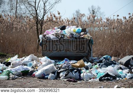 Garbage Can Is Packed With Garbage And Waste. Untimely Removal Of Garbage In Populated Areas