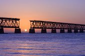 Colorful panoramic landscape of a beautiful sunset at Bahia Honda state park in Florida and the old historic landmark, the Flagler railway bridge that used to connect Miami and Key West. poster