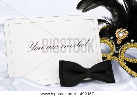 Invitation to mask party place on white satin poster