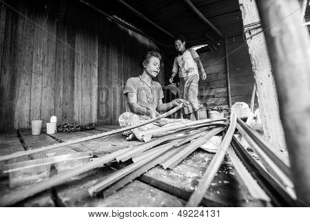 BERDUT, MALAYSIA - APR 8: Unidentified woman Orang Asli in his village (b/w photo) on Apr 8, 2013 in Berdut, Malaysia. More than 76% of all Orang Asli live below the poverty line.