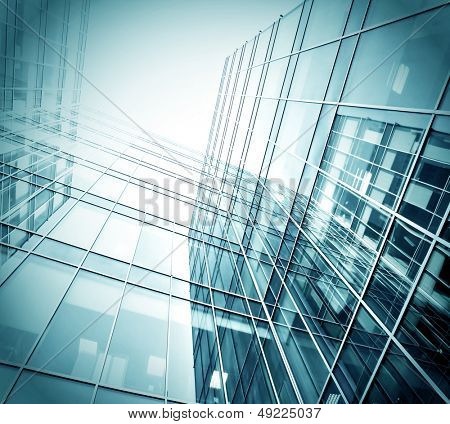 Panoramic and perspective wide angle view to steel blue background of glass high rise building skyscrapers in modern futuristic downtown over sky Business concept of successful industrial architecture
