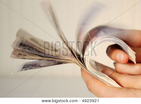Hand Holding A Wad Of Twenty Pound Notes