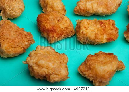 Breaded boneless wings on turquoise surface