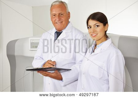 Doctor and female physician as team in radiology in a hospital