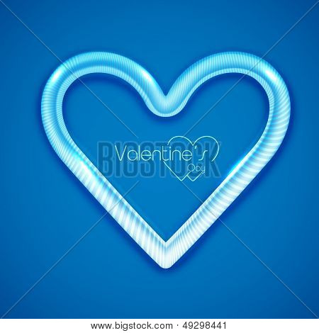 Shiny heart shape on blue background for Valentines Day.